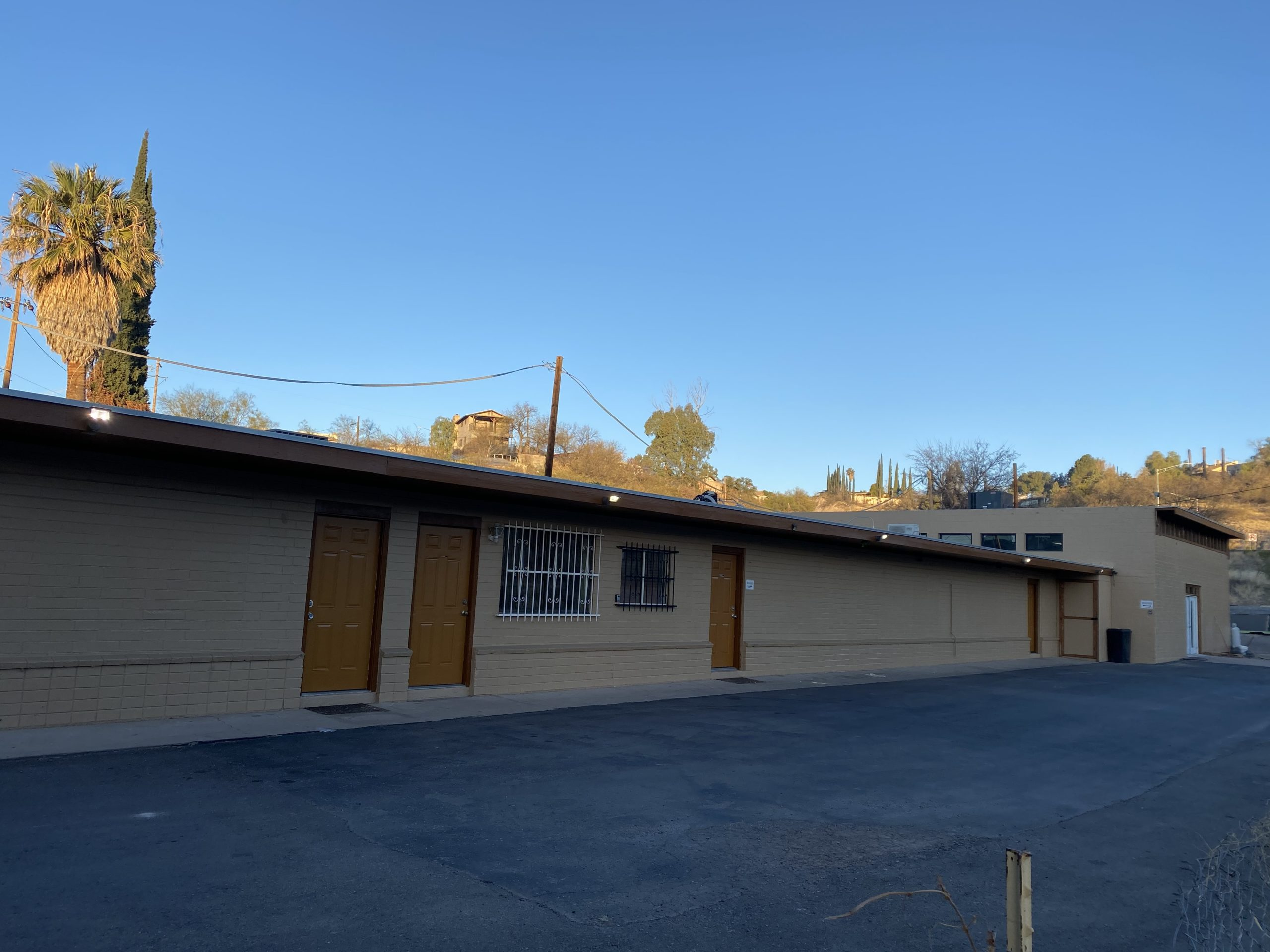 Buyer can continue the lease at $5000/mo, purchase the building from the company owner, or re-locate the company.